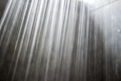Detail close-up of a shower head water stream. royalty free stock photos