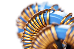 Detail Close-up View of three Industrial Toroidal Choke Coils Stock Photo