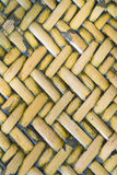 Detail close up view of a uniform golden woven basket using natural branch materials.Pattern of Thai style bamboo handcraft stock photos