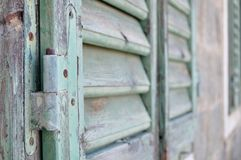 Detail of closed old wooden shutter Royalty Free Stock Photo