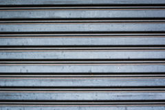 Detail of closed steel security shutters. Close-up detail of closed steel security shutters stock photos