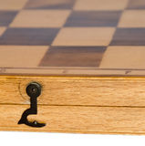 Detail of a closed wooden chess board Stock Image
