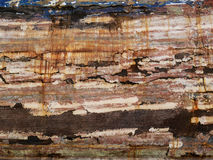 Detail and closeup of old and colored boat wooden hull, old painting with cracks and wood texture. Amazing picturesque background looking like modern abstract stock image