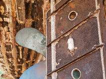 Detail and closeup of old and colored boat wooden hull, old painting with cracks and wood texture. Amazing picturesque background looking like modern abstract royalty free stock images