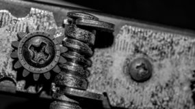 Detail closeup of turning peg of acoustic guitar. monochrome royalty free stock images