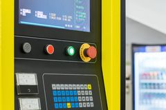 Detail of CNC machine control panel. Shallow depth of field stock image