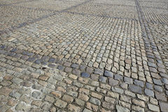 Detail of a cobbled road Stock Photos
