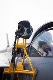 Detail of cockpit of military airplane. Detail of military fighter/interceptor/jetplane cockpit with pilot's oxygen mask and helmet, ready to take off in case of Stock Photography