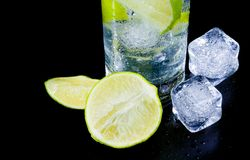Detail of cocktail with ice and lime slice and space for text Stock Photo