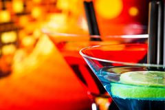 Detail of cocktail with light disco bokeh background with space for text Stock Photos