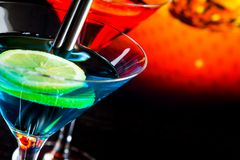 Detail of cocktail with light disco bokeh background with space for text Royalty Free Stock Images