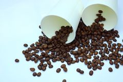 Coffee beans with paper cups. Detail of coffee beans with paper cups Royalty Free Stock Photo