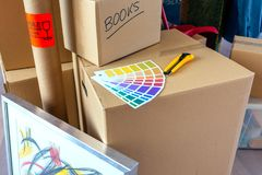 Detail of color palette and cutter. Over moving boxes Stock Images