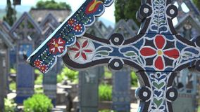 Detail of colored cross in Merry Cemetery, Sapanta, Romania. UHD 4K stock video