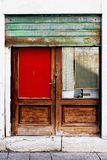 Detail of a colored door with damper in Venice Royalty Free Stock Photos