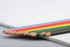 Detail of colored pencil points. Detail of sharpened colored pencils aligned on a white paper Royalty Free Stock Images