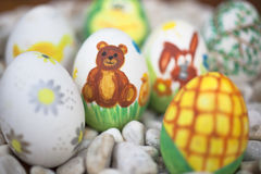 Detail of colorful blurred painted Easter eggs with different fo Stock Photos