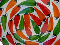 Detail of colorful chili pepper clay plate Stock Photography