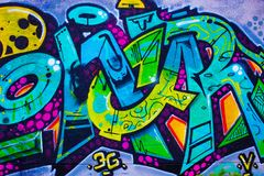 Graffiti detail over the wall. Detail of a colorful graffiti on a wall, abstract background royalty free stock photos