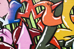 Detail of colorful illegal graffiti on public wall. Stock Photography