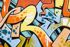 Detail of colorful illegal graffiti on public wall. Stock Photos