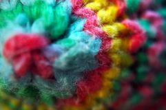 Detail of a colorful knitted textile design. Coloful knitted yarn polygon figure Macro detail Stock Photos