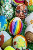 Detail of colorful, painted Easter eggs with different forms and Stock Photos