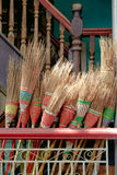 Detail of colorful rustic brooms in wooden stairway Royalty Free Stock Image