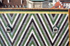 Austria, Vienna, capital city cityscape, tiled roof with pattern of St. Stephen`s Cathedral stock photo
