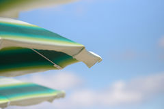 Detail of colorful umbrellas on the beach on a sunny summer day. royalty free stock image