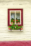 Detail of colorful window with flowers on old traditional house Royalty Free Stock Photo