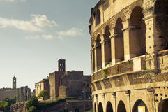 Detail of the Colosseum in Rome, Italy. Detail of the Colosseum and churches in Rome, Italy royalty free stock images