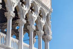 Detail of columns of the Doge`s Palace in Venice. Italy with blue sky in the background Royalty Free Stock Photos