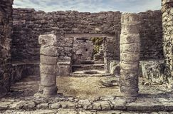 Columns of the Mayan ruins of Tulum. Detail of the columns of a Mayan temple of the tulum complex in mexico stock image