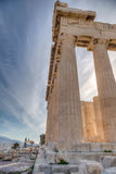 Detail of the columns of the Parthenon, Athens. Detail of the columns of the Parthenon, against blue summer sky with wispy clouds, Athens, Greece royalty free stock photography