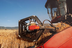 Detail of a combine harvester in action Stock Photo