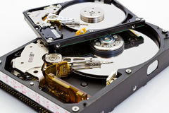 Detail comparison of 2.5 and 3.5 disk drive. Detail comparison of  an open 2.5 and 3.5 disk drive on a white background Royalty Free Stock Image