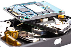 Detail comparison of 2.5 ,  3.5 HDD and SSD. Detail comparison of  an open 2.5 disk drive,  3.5 disk drive and SSD on a white background Stock Image