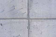 Detail of a concrete surface with a cross joint and side incident light. Detail of a dirty concrete surface with a cross joint and side incident light stock image