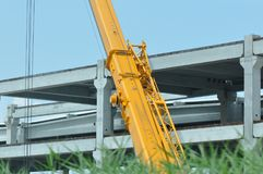 Construction crane. Detail of construction crane with blurry sky on the background stock photo