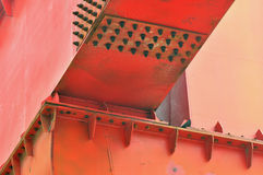 Detail of construction equipment. Part of an gantry crane, a kind of construction equipment, with lay out and shadow from screw Royalty Free Stock Photography