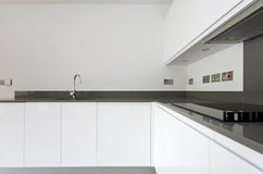 Detail of contemporary fully fitted kitchen in white stock images