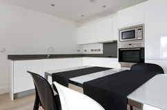Detail of contemporary fully fitted kitchen in white Royalty Free Stock Images