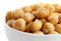 Detail of cooked chickpeas in white bowl. Royalty Free Stock Image