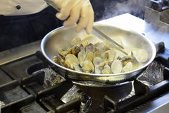 Detail cooking of Clams in a pan Stock Images