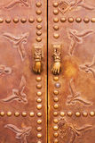 Detail of a copper door in Marrakesh. Detail of a copper door the UNESCO protected old town of Marrakesh, Morocco royalty free stock images