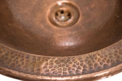 Detail of copper round sink. Brown copper sink in retro style. Antique sink for home. Macro shooting. Brass sink in retro style. Antique sink for home on white stock photos