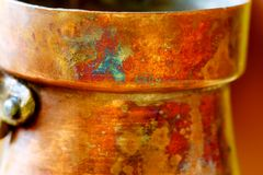 Detail copper structure on old coffee maker. Brown and orange background. Stock Image