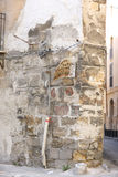 Detail of the corner. Of an old stone house with wiring and oldness of signboard in Palermo, Italy. Text: `Welding work Electric and gas welding Royalty Free Stock Photo