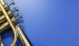 Detail of a cornet. On a blue background Royalty Free Stock Photos